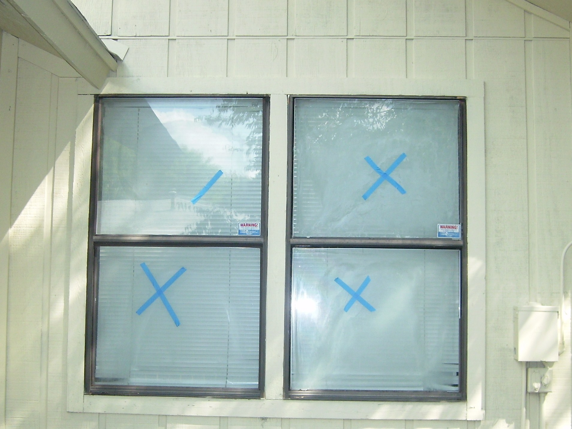 fogged insulated glass for repair austin tx with dark aluminum frames rental property window repair