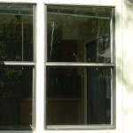 Clear insulated glass in aluminum frame from new installation Austin Tx