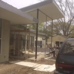 House pictured with screen enclosure in progress in Austin Tx